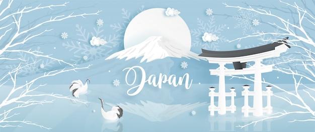 Panorama van reisprentbriefkaar, affiche beroemde oriëntatiepunten van japan met fuji-berg in de winter Premium Vector