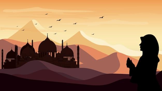 Panoramalandschap silhouet van één vrouwen die op de woestijnachtergrond bidden tijdens de ramadanmaand Premium Vector