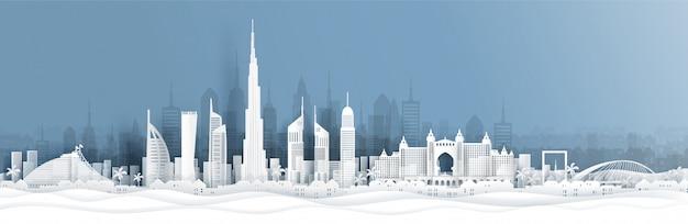 Panoramamening van de horizon van doubai en van de stad met wereldberoemde oriëntatiepunten in document besnoeiingsstijl Premium Vector