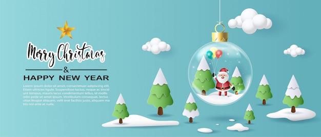 Papier kunststijl van santa claus-ballons in kerstmisbal houden. Premium Vector