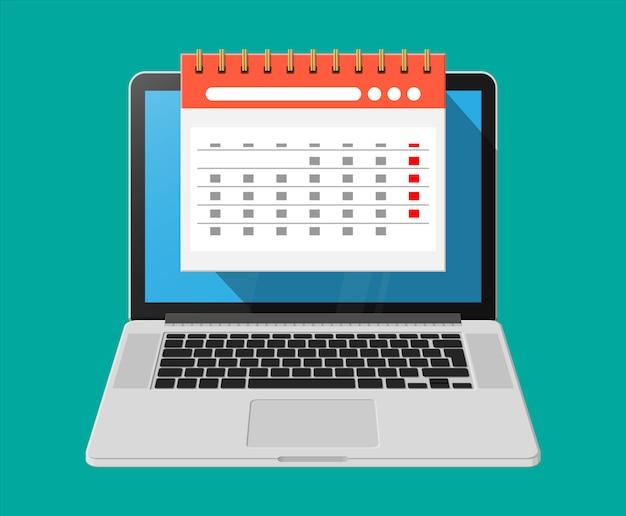 Papier spiraal wandkalender in laptop Premium Vector