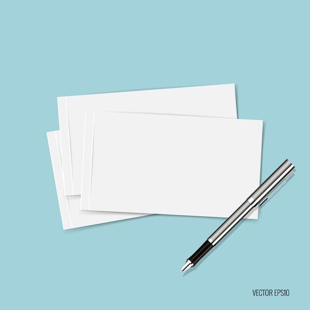 Papieren en pen op blauwe achtergrond Gratis Vector