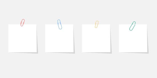 Papieren sticker met paperclip set met schaduw geïsoleerd op een grijze achtergrond Premium Vector