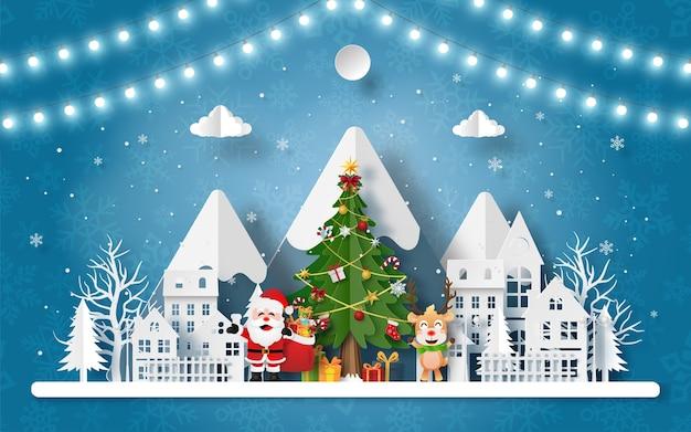 Papierkunst van de kerstman en rendieren in het dorp bij de sneeuwberg Premium Vector