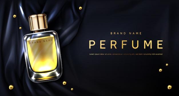 Parfumfles op zwarte zijden stof Gratis Vector