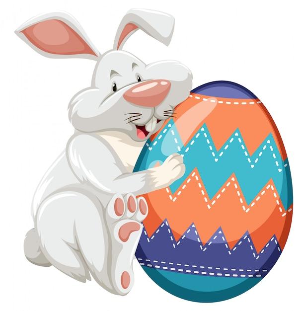 Pasen-thema met verfraaid ei in kleurrijke patronen Gratis Vector