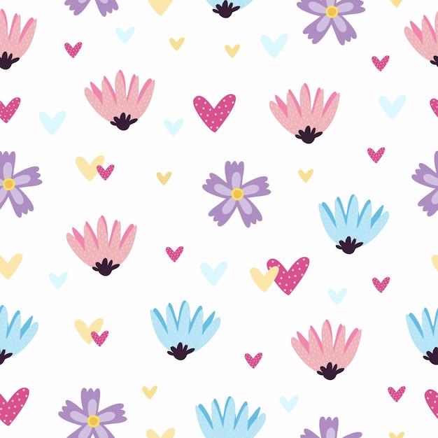 Patroon met hartjes en bloemen Gratis Vector