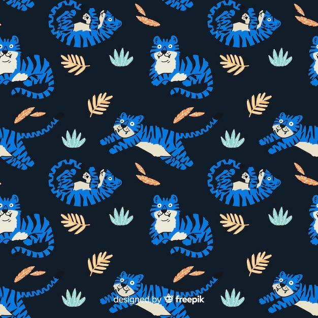 Patroon van hand getrokken tijgers Gratis Vector