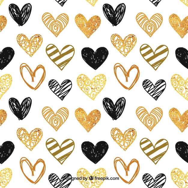 Patroon van handgeschilderde gouden en zwarte harten Gratis Vector