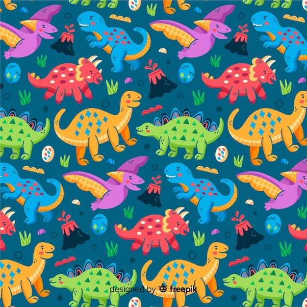 Patroonachtergrond van kleurrijke dinosaurus Gratis Vector