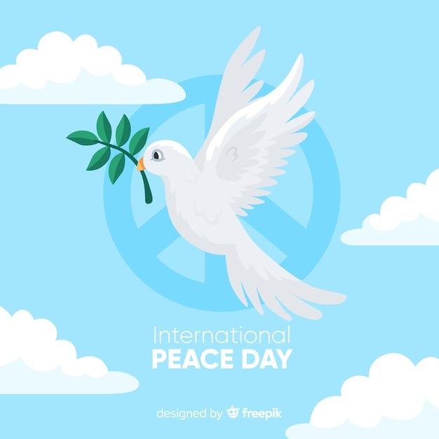 Peace day concept met een duif Gratis Vector
