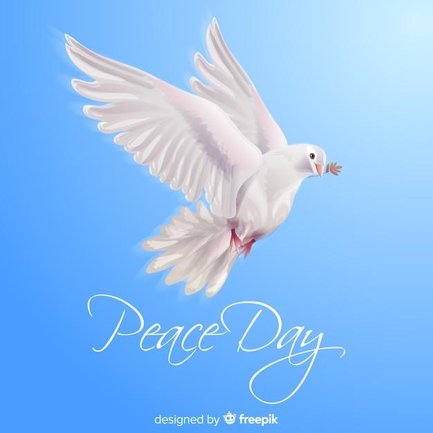 Peace day concept met realistische duif Gratis Vector