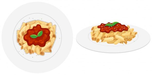Pennedeegwaren met tomatensaus Gratis Vector