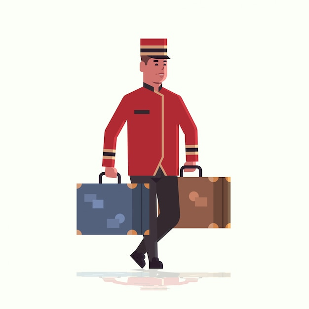 Piccolo uitvoering koffers service concept piccolo bedrijf bagage mannelijke hotel werknemer in uniform Premium Vector