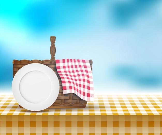 Picknickmand op tafel en lente landschap Premium Vector