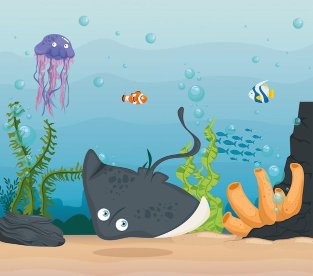 Pijlstaartrog en zeedieren in de oceaan, bewoners van de zeewereld, schattige onderwaterwezens, onderzeese fauna Premium Vector