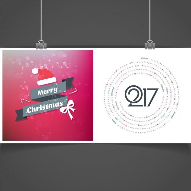 Pink merry christmas gloeiende kaart met kalender Gratis Vector