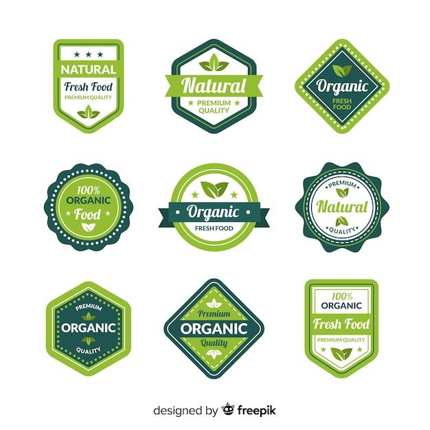 Platte collectie van biologisch voedseletiketten Gratis Vector
