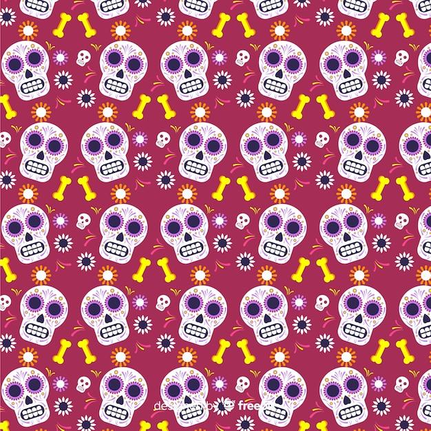 Platte día de muertos rood met schedels patroon Gratis Vector