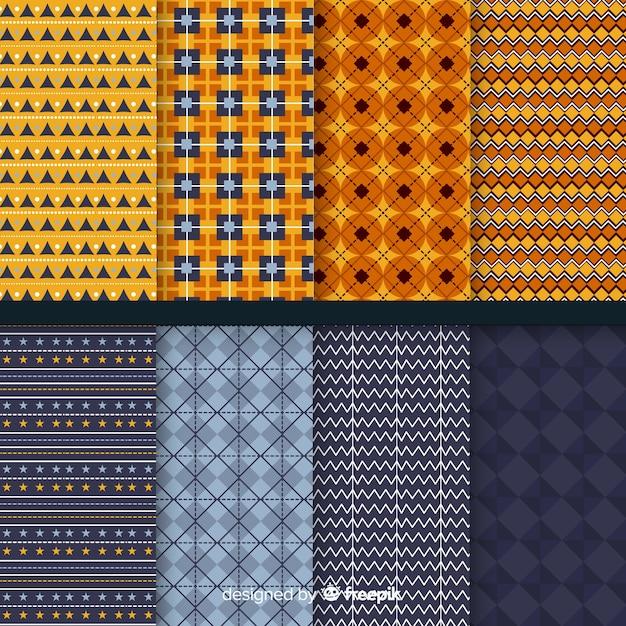 Platte geometrische halloween patrooncollectie Gratis Vector