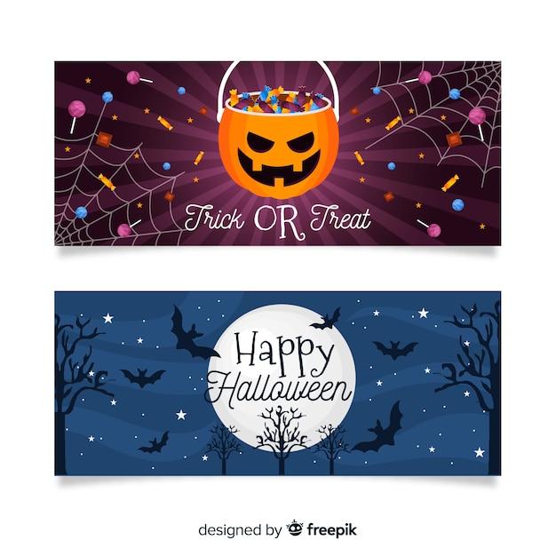Platte halloween banners met zak snoep en maan Gratis Vector