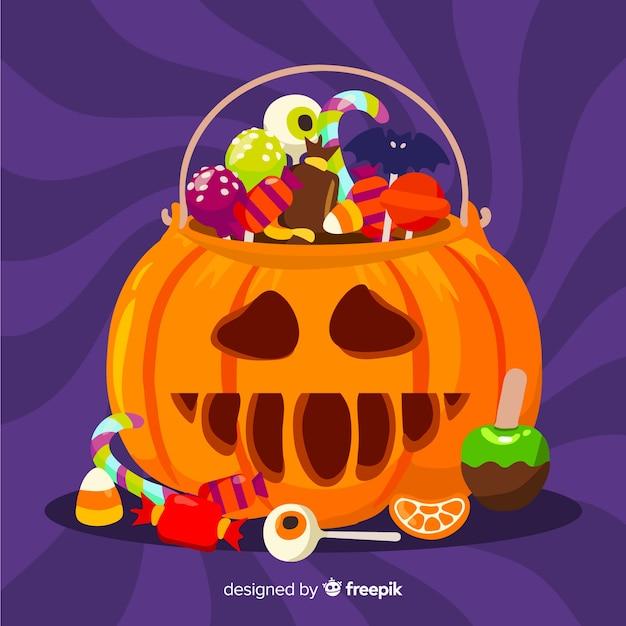 Platte halloween gesneden pompoen tas Gratis Vector