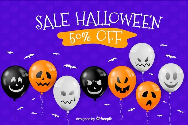 Platte halloween verkoop achtergrond met ballonnen Gratis Vector