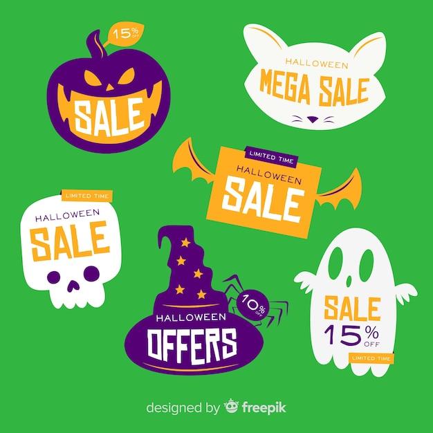 Platte halloween verkoop label collectie op groene achtergrond Gratis Vector