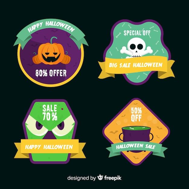 Platte halloween verkoop label en badge collectie op zwarte achtergrond Gratis Vector