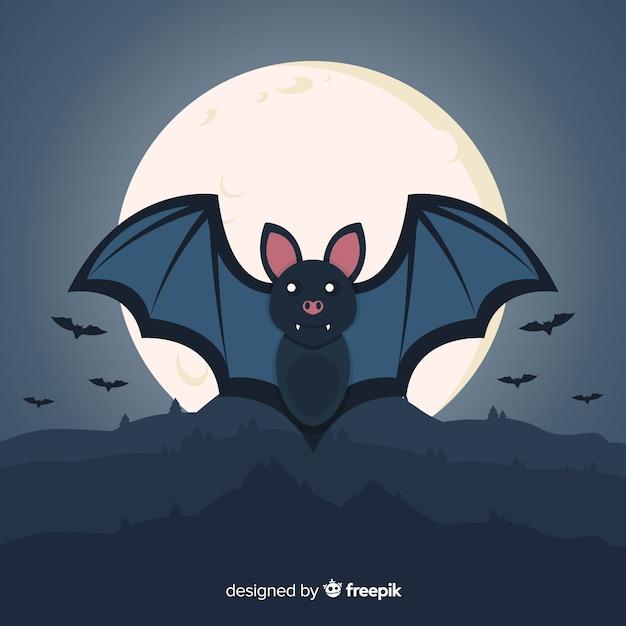 Platte halloween vleermuis op een volle maan nacht Gratis Vector