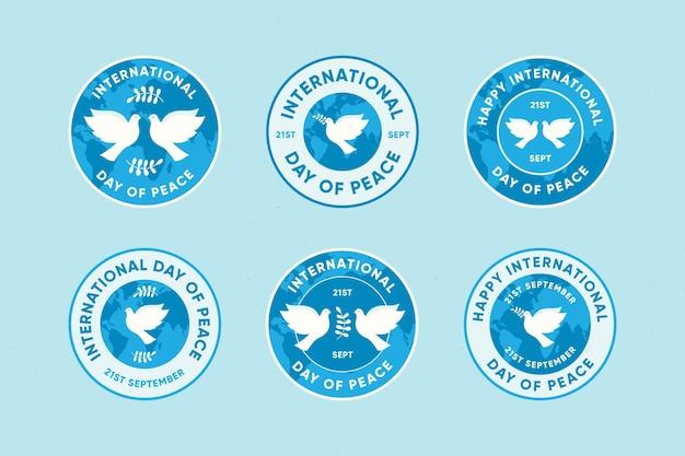 Platte internationale dag van vredesetiketten Gratis Vector