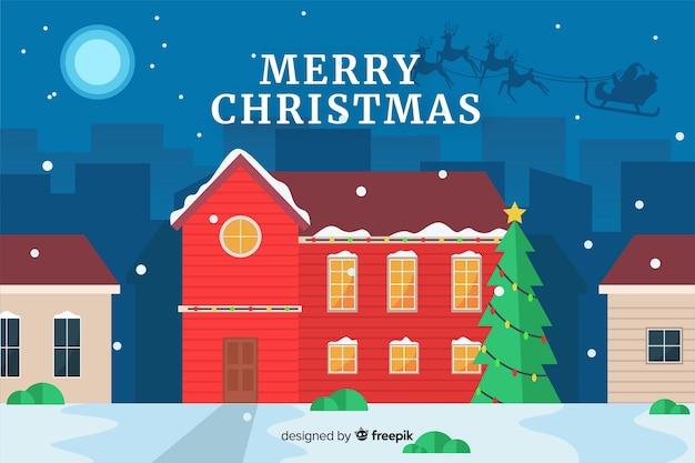 Platte kerst achtergrond gezellig huis en kerstboom Gratis Vector
