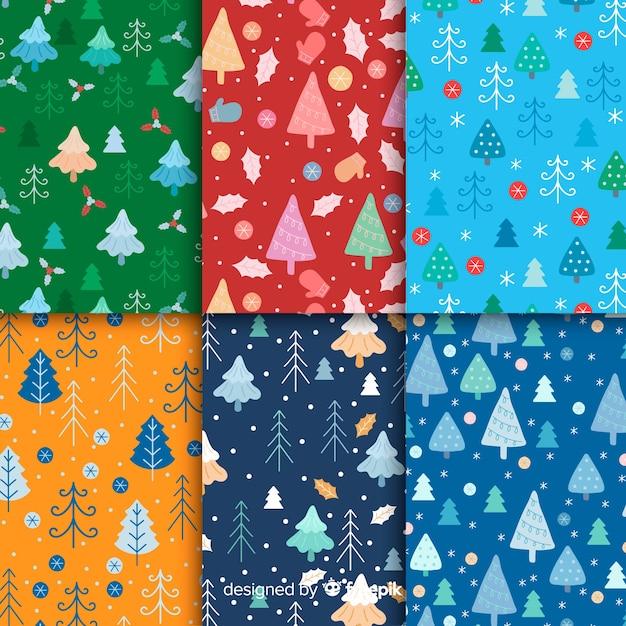 Platte kerst patroon collectie met bomen Gratis Vector