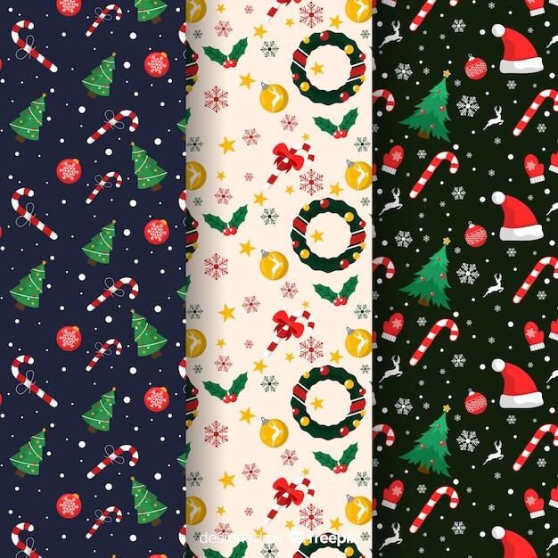Platte kerst patroon collectie met krans en bomen Gratis Vector