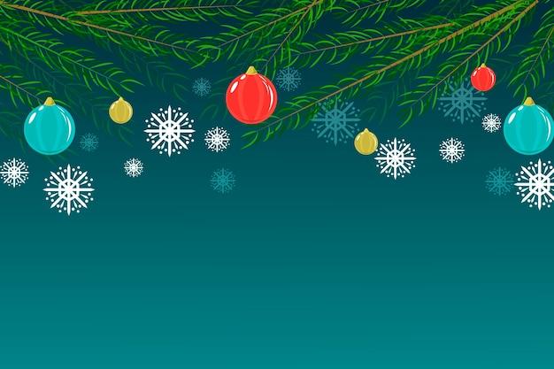 Platte kerstboom takken achtergrond Gratis Vector