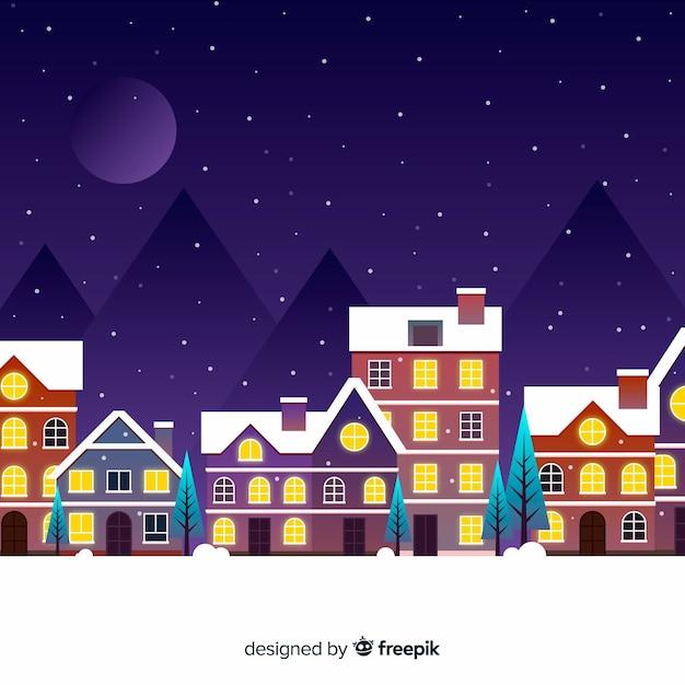 Platte kerststad in de nacht met maan Gratis Vector