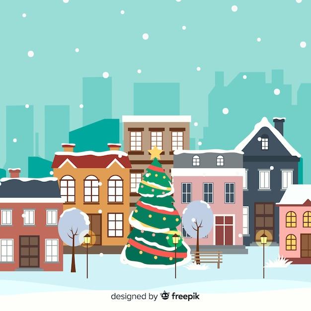 Platte kerststad met kerstboom Gratis Vector