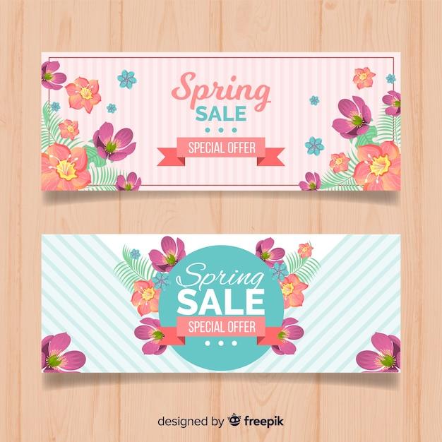 Platte lente verkoop banners Gratis Vector