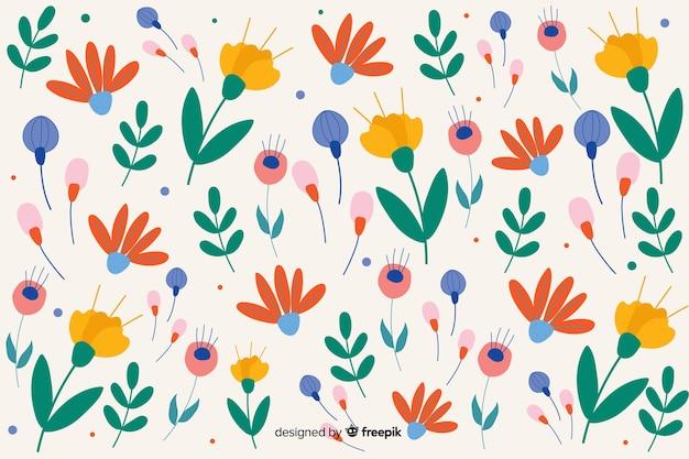 Platte ontwerp bloemmotief achtergrond Gratis Vector