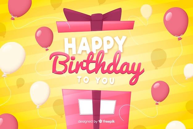 Platte ontwerp gelukkige verjaardag achtergrond met cadeau Gratis Vector