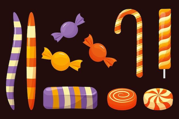 Platte ontwerp halloween snoep set Gratis Vector