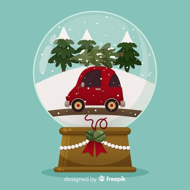 Platte ontwerp kerst sneeuwbal wereldbol met auto Gratis Vector