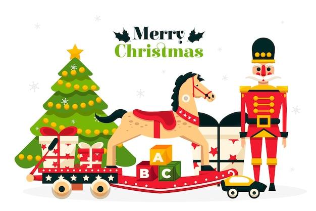 Platte ontwerp kerst speelgoed achtergrond Gratis Vector