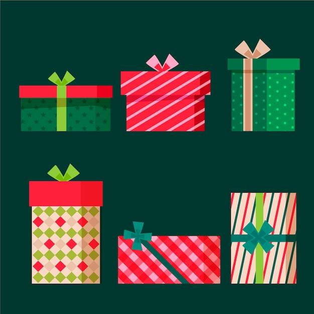 Platte ontwerp kerstcadeauset Gratis Vector