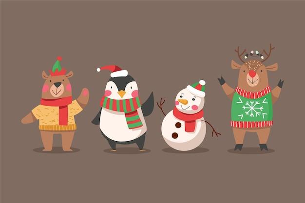 Platte ontwerp kerstkarakterverzameling Gratis Vector