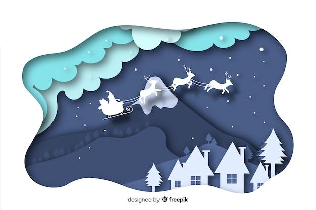 Platte ontwerp kerstmis stad achtergrond Gratis Vector