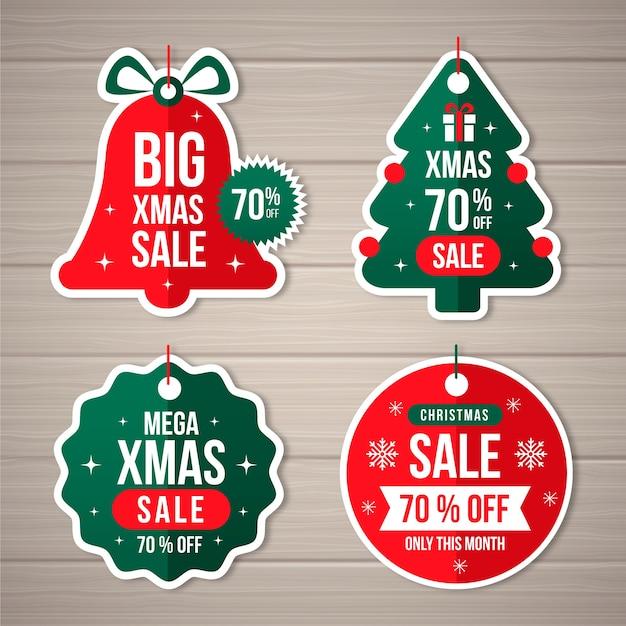 Platte ontwerp kerstmis verkoop tag collectie Gratis Vector