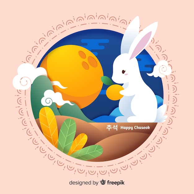 Platte ontwerp konijntje met sinaasappel Gratis Vector