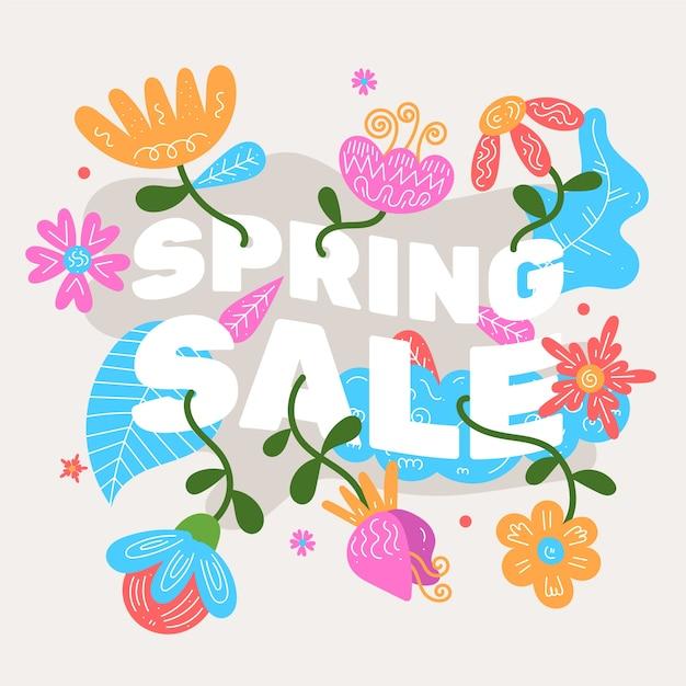 Platte ontwerp lente verkoop met kleurrijke bloemen Gratis Vector
