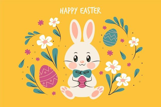 Platte ontwerp pasen dag bunny omringd door bloemen Gratis Vector